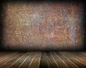 Indoor backdrop with distressed rusty wall — Stock Photo