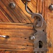 Ancient latch on beautiful wooden door — Stock Photo
