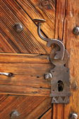 Ancient latch on beautiful wooden door — Photo