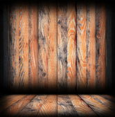Grungy wood surfaces on wall and floor — Stockfoto
