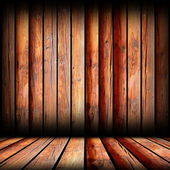Reddish boards on indoor backdrop — Stock Photo