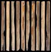 Damaged planks on dark background — Stock Photo