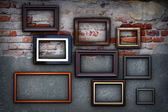 Frames on cracked ancient wall — Stock Photo