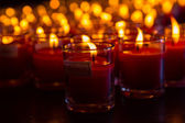 Church candles in red transparent chandeliers — Stock Photo