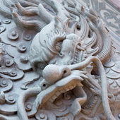 Dragon carved from stone — Stock Photo
