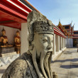 Bangkok Thailand - Jan 03 : Chinese stone guardian statue in Wat — Stock Photo