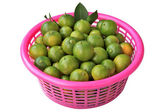 Oranges with leaves in a pink basket — Stock Photo