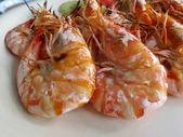 Grilled shrimps on white dish — Stock Photo