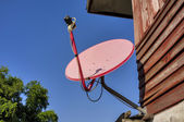 Satellite dish attached to the home. — Fotografia Stock