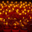 Church candles in red transparent chandeliers — Stock Photo #41807419