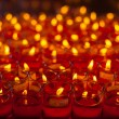 Church candles in red transparent chandeliers — Stock Photo #41807501