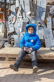 Boy waiting at the meeting point in front of Nami Island. — Stock Photo