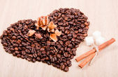 Heart of coffee beans with rose — Stock Photo
