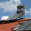 图库照片: Solar heater on roof
