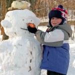 Boy making snowman — Stock Photo