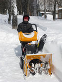 Snow removal with a snowblower — Stock Photo