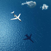 Airplane flies over a sea — Stock Photo