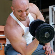 Stock Photo: Bodybuilder in gym