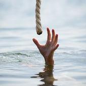Saving a drowning man — Stock Photo