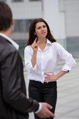 Emotional conversation between men and women — Stock Photo