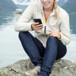 Young blond woman with her Smartphone in the hand — Stock Photo #13859168