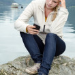 Have young blond woman with her Smartphone in the hand — Lizenzfreies Foto