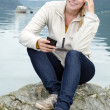 Young blond woman with her Smartphone in the hand — Stock Photo #13859304