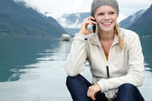 Young blond woman called up with her Smartphone — Foto Stock