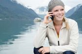 Young blond woman called up with her Smartphone — Stockfoto