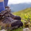 Tramping boots on a stone - Stock Photo