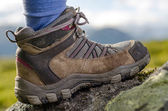 Tramping boots on a stone — Stock Photo