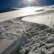 Stock Photo: Snow track goes downhill