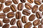 Many espresso beans before white background — Stock Photo