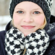 Young blond woman with beanie and scarf winter wood portrait — Stock Photo #22351213