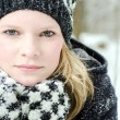 Young blond woman with beanie and scarf winter wood portrait — Stock Photo #22351267