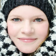 Young blond woman with beanie and scarf winter wood portrait — Stock Photo #22351325