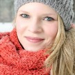 Young blond woman with beanie and scarf winter wood portrait — Stock Photo #22351543