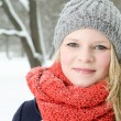 Young blond woman with beanie and scarf winter wood portrait — Стоковая фотография