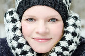 Young blond woman with beanie and scarf winter wood portrait — Foto de Stock