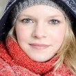 Young blond woman with beanie and scarf winter wood portrait — Stock Photo #22562563
