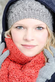 Young blond woman with beanie and scarf winter wood portrait — Zdjęcie stockowe