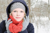 Young blond woman with beanie and scarf winter wood portrait — ストック写真