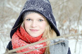 Young blond woman with beanie and scarf winter wood portrait — 图库照片