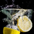 Royalty-Free Stock Photo: Two halved lemons splash into water
