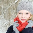 Young blond woman with beanie and scarf winter wood portrait — Lizenzfreies Foto