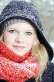 Young blond woman with beanie and scarf winter wood portrait — Foto Stock