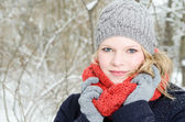 Young blond woman with beanie and scarf winter wood portrait — Stok fotoğraf
