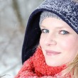 Young blond womwith beanie and scarf winter wood portrait — Zdjęcie stockowe #29599287