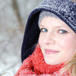 Stockfoto: Young blond womwith beanie and scarf winter wood portrait