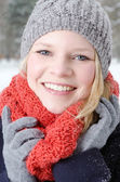 Young blond woman with beanie and scarf winter wood portrait — Photo